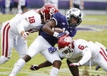 Oklahoma linebacker Curtis Bolton (18) and cornerback Tre Brown (6) tackle TCU wide receiver Derius Davis (12) during the first half of an NCAA college football game, Saturday, Oct. 20, 2018, in Fort Worth, Texas. Oklahoma won 52-27. (AP Photo/Brandon Wade)