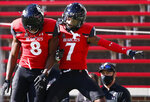 Cincinnati wide receiver Michael Young Jr. (8) and wide receiver Tre Tucker (7) celebrate Tucker's touchdown against Memphis during the second half of an NCAA college football game Saturday, Oct. 31, 2020, in Cincinnati. Cincinnati won 49-10. (Photo by Gary Landers)