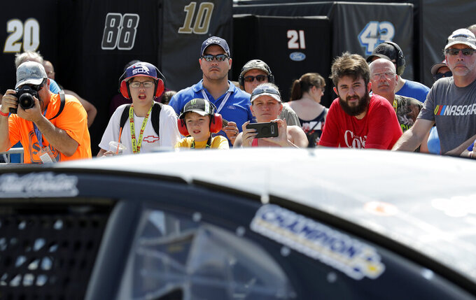 NASCAR fans watch Reed Sorenson's car during a practice for the NASCAR Sprint Cup Series auto race at Chicagoland Speedway in Joliet, Ill., Saturday, June 29, 2018. (AP Photo/Nam Y. Huh)