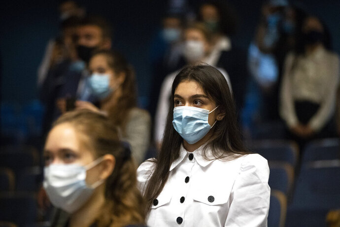Students of the MGIMO (Moscow State Institute for Foreign Relations) wearing face masks to protect against coronavirus attend a meeting with Russian Foreign Minister Sergey Lavrov in Moscow, Russia, Tuesday, Sept. 1, 2020. Russia's tally of confirmed coronavirus cases has surpassed 1 million after authorities reported 4,729 new cases. With a total of 1,000,048 reported cases up to Tuesday, Russia has the fourth largest caseload in the world after the U.S., Brazil and India. (AP Photo/Pavel Golovkin)