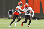 Cleveland Browns cornerback Greedy Williams (26) defends against Emmanuel Rugamba (37) during an NFL football practice at the team's training facility Wednesday, June 9, 2021, in Berea, Ohio. (AP Photo/Ron Schwane)