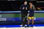 West Virginia coach Bob Huggins talks with Jalen Bridges during the first half of the team's NCAA college basketball game against Gonzaga, Wednesday, Dec. 2, 2020, in Indianapolis. (AP Photo/Darron Cummings)