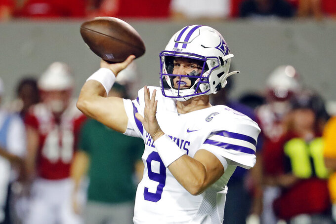 Furman's Hamp Sisson (9) passes the ball against North Carolina State during the first half of an NCAA college football game in Raleigh, N.C., Saturday, Sept. 18, 2021. (AP Photo/Karl B DeBlaker)