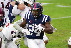 Mississippi running back Snoop Conner (24) scores a 1-yard touchdown against Mississippi State during the first half of an NCAA college football game, Saturday, Nov. 28, 2020, in Oxford, Miss. (AP Photo/Rogelio V. Solis)
