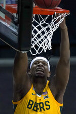 Baylor's Flo Thamba shoots against Oklahoma State during the first half of an NCAA college basketball game in the semifinals of the Big 12 tournament in Kansas City, Mo., Friday, March 12, 2021. (AP Photo/Charlie Riedel)