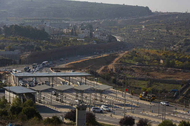 Roadworks expand a road to Israeli settlements inside the West Bank, near the city of Bethlehem, Sunday, Nov. 29, 2020. In years to come, Israelis will be able to commute into Jerusalem and Tel Aviv from settlements deep inside the West Bank via highways, tunnels and overpasses that cut a wide berth around Palestinian towns. Rights groups say the new roads that are being built will set the stage for explosive settlement growth, even if President-elect Joe Biden's administration somehow convinces Israel to curb its housing construction. (AP Photo/Majdi Mohammed)