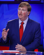 Lt. Gov. Tate Reeves answers a question during a GOP gubernatorial runoff debate against former Mississippi Supreme Court Chief Justice and gubernatorial candidate Bill Waller Jr., unseen, in Jackson, Miss., Wednesday, Aug. 21, 2019. (AP Photo/Rogelio V. Solis)