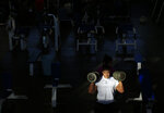 In this June 9, 2019 photo, Mexican bodybuilder Carlos Suarez trains for the upcoming Pan Am Games at the Mexican Olympic Committee facilities in Mexico City. Suarez begins his weight-lifting session before dawn and spends a total of six hours every day getting his body in peak shape for the games. (AP Photo/Rebecca Blackwell)