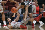 Stanford center Josh Sharma, bottom, reaches for the ball next to Washington State forward Davante Cooper during the first half of an NCAA college basketball game in Stanford, Calif., Thursday, Feb. 28, 2019. (AP Photo/Jeff Chiu)