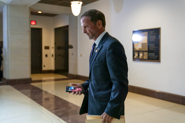 FILE - In this Thursday, Sept. 19, 2019 file photo, Rep. Chris Stewart, R-Utah, a member of the House Intelligence Committee, leaves a meeting with national intelligence inspector general Michael Atkinson about a whistleblower complaint, at the Capitol in Washington. As Democrats champion anti-discrimination protections for the LGBTQ community and Republicans counter with worries about safeguarding religious freedom, Rep. Chris Stewart is offering a proposal on Friday, Dec. 6, 2019 that aims to achieve both goals. (AP Photo/J. Scott Applewhite, File)