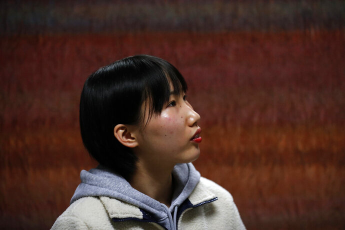 In this Nov. 6, 2019, photo, Song Hong Ryon, pauses for a moment during an interview in Uijeongbu, South Korea. Song Hong Ryon looks like any other young woman in South Korea. But three years after her arrival from China, the half-North Korean, half-Chinese 19-year-old has made only two South Korean-born friends and says she's often been hurt by little things, like when people ask if she's from China because of her accent.(AP Photo/Lee Jin-man)