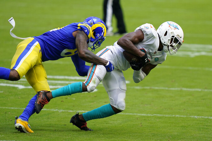 Miami Dolphins free safety Eric Rowe (21) intercepts a pass intended for Los Angeles Rams tight end Gerald Everett (81), during the first half of an NFL football game, Sunday, Nov. 1, 2020, in Miami Gardens, Fla. (AP Photo/Lynne Sladky)