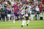 United States' Tyler Adams, left, and Costa Rica's Bryan Ruiz chase the ball during the second half of a World Cup qualifying soccer match Wednesday, Oct. 13, 2021, in Columbus, Ohio. The United States won 2-1. (AP Photo/Jay LaPrete)