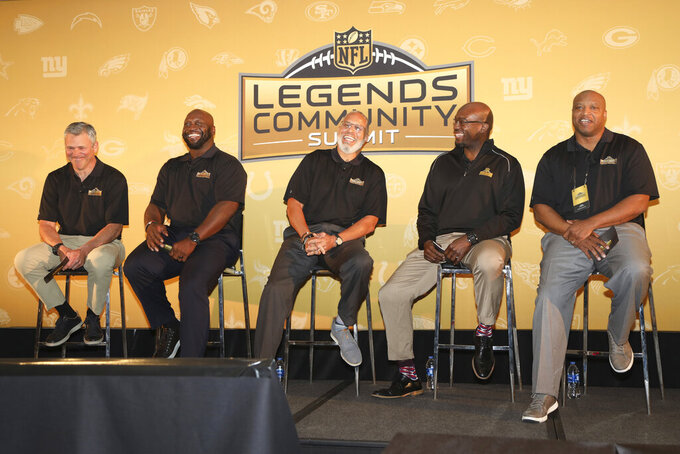 "From left: Mark Brunell, John Randle, Ed Reynolds, Will Shields and Mack Strong smile during the 2019 NFL Legends Community Summit in Ft. Lauderdale, Fla., Monday, April 1, 2019. Randle, the dynamic defensive lineman for Minnesota and Seattle over 14 seasons _ is a director for the NFL Legends Community. The organization, launched six years ago, ""celebrates, embraces and connects players with each other, their teams and the league,"" and recently hit 10,000 members.(James McEntee/AP Images for NFL)"