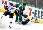 St. Louis Blues left wing Jaden Schwartz (17) and center Ryan O'Reilly (90) work against Dallas Stars defenseman John Klingberg (3) for control of the puck during the first period of an NHL hockey game in Dallas, Thursday, Feb. 21, 2019. (AP Photo/Tony Gutierrez)
