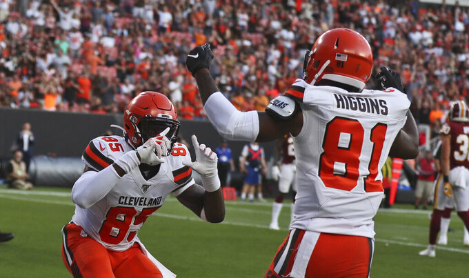 Cleveland Browns tight end David Njoku (85) celebrates after Cleveland Browns wide receiver Rashard Higgins (81) scored a 24-yard touchdown during the first half of an NFL preseason football game against the Washington Redskins, Thursday, Aug. 8, 2019, in Cleveland. (AP Photo/Ron Schwane)