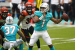 Miami Dolphins quarterback Tua Tagovailoa (1) looks to pass the football during the first half of an NFL football game against the Cincinnati Bengals, Sunday, Dec. 6, 2020, in Miami Gardens, Fla. (AP Photo/Wilfredo Lee)