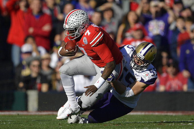 Ohio State quarterback Dwayne Haskins gets sacked by Washington linebacker Ryan Bowman during the first half of the Rose Bowl NCAA college football game Tuesday, Jan. 1, 2019, in Pasadena, Calif. (AP Photo/Mark J. Terrill)