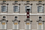 Pope Francis reads out his message during the Angelus noon prayer from the window of his studio overlooking St.Peter's Square, at the Vatican, Sunday, Oct. 25, 2020. (AP Photo/Alessandra Tarantino)