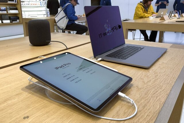 An iPad Pro and a Macbook Pro are displayed an Apple store Tuesday, Jan. 28, 2020, in suburban Boston. Apple reports financial earns on Tuesday. (AP Photo/Steven Senne)