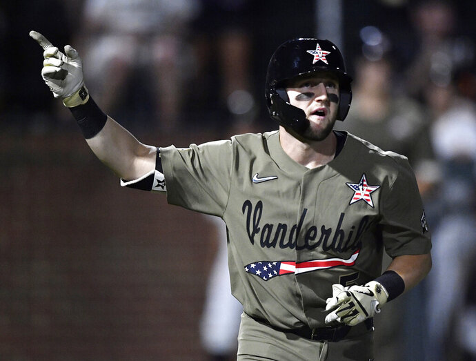"""FILE - In this June 2, 2019, file photo, Vanderbilt's Philip Clarke (5) points to the sky after hitting a home run in the bottom of the fourth inning against Indiana State during an NCAA college baseball regional game in Nashville, Tenn. The College World Series has an even stronger Southeastern Conference flavor than usual. """"The background on my phone is TD Ameritrade Park,"""" said Vanderbilt catcher Philip Clarke, referring to the site of the College World Series. """"That's definitely an expectation, to go there every year."""" (George Walker IV/The Tennessean via AP, File)"""