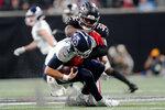 Atlanta Falcons safety Jaylinn Hawkins (32) sacks Tennessee Titans quarterback Logan Woodside (5) during the first half of a preseason NFL football game, Friday, Aug. 13, 2021, in Atlanta. (AP Photo/John Bazemore)