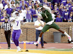 William & Mary's Isaiah Laster, right, intercepts a pass against James Madison's Jawon Hamilton, left, during the first half of of an NCAA college football game in Williamsburg, Va., on Saturday, Oct. 19, 2019.  (Daniel Sangjib Min/Richmond Times-Dispatch via AP)