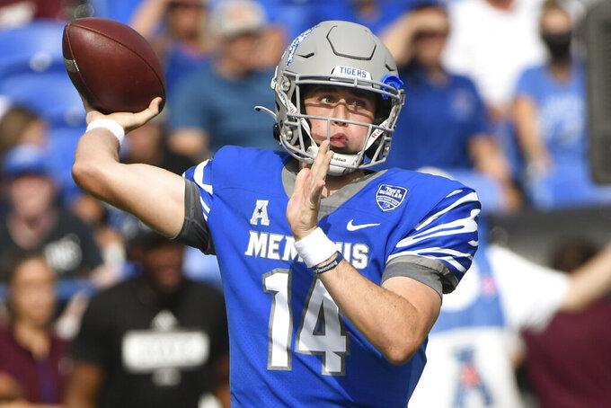 Memphis quarterback Seth Henigan passes against Memphis during the first half of an NCAA college football game on Saturday, Sept. 18, 2021, in Memphis, Tenn. (AP Photo/John Amis)