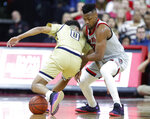 North Carlolina State's Torin Dorn (2) knocks the ball from Georgia Tech's Michael Devoe (0) during the first half of an NCAA college basketball game in Raleigh, N.C., Wednesday, March, 6, 2019. (Ethan Human/The News & Observer via AP)