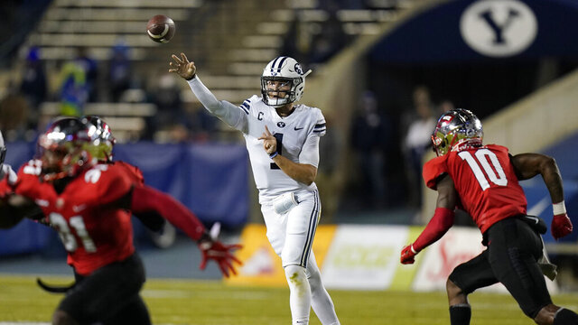 BYU quarterback Zach Wilson (1) throws a pass against Western Kentucky during the first half of an NCAA college football game Saturday, Oct. 31, 2020, in Provo, Utah. (AP Photo/Rick Bowmer, Pool)