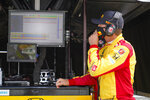 Ryan Hunter-Reay looks over data during practice for the Indianapolis 500 auto race at Indianapolis Motor Speedway in Indianapolis, Friday, Aug. 14, 2020. (AP Photo/Michael Conroy)