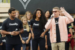 Seattle Seahawks NFL football quarterback Russell Wilson, left, and his wife, pop singer Ciara, center, listen as hip-hop artist Macklemore, right, speaks Monday, Aug. 19, 2019, during an event in Seattle held to introduce themselves and others as new members of the MLS soccer Seattle Sounders team's ownership group. (AP Photo/Ted S. Warren)