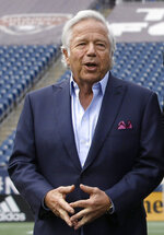 FILE - In this May 9, 2019, file photo, New England Patriots owner Robert Kraft stands in Gillette Stadium in Foxborough, Mass. A Florida judge has blocked prosecutors from using video that allegedly shows Kraft engaging in paid sex at a massage parlor. Judge Leonard Hanser ruled Monday, May, 13, 2019, that Jupiter police did not follow proper procedures after installing the hidden cameras that secretly recorded Kraft visiting the Orchids of Asia Day Spa twice in January. (AP Photo/Steven Senne, File)