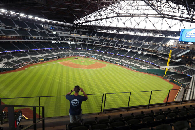 Baseball fan Mark Southard, of Wichita Falls, Texas, takes a photo during a tour of Globe Life Field, the new home of the Texas Rangers baseball team, Monday, June 1, 2020, in Arlington, Texas. (AP Photo/LM Otero)