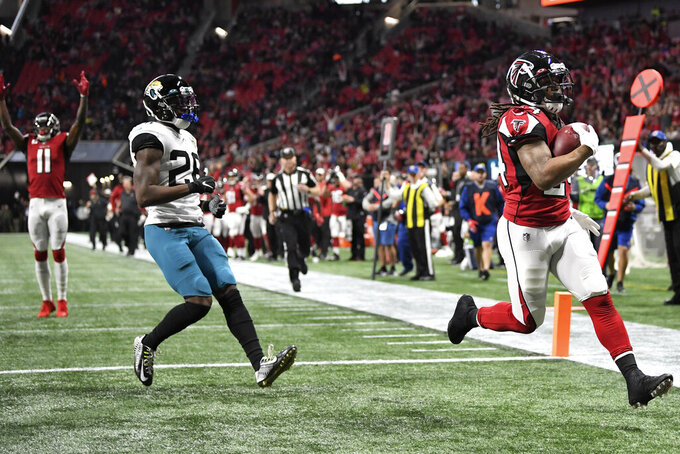 Atlanta Falcons running back Devonta Freeman (24) runs to the end zone for a touchdown against the Jacksonville Jaguars during the first half of an NFL football game, Sunday, Dec. 22, 2019, in Atlanta (AP Photo/Danny Karnik)