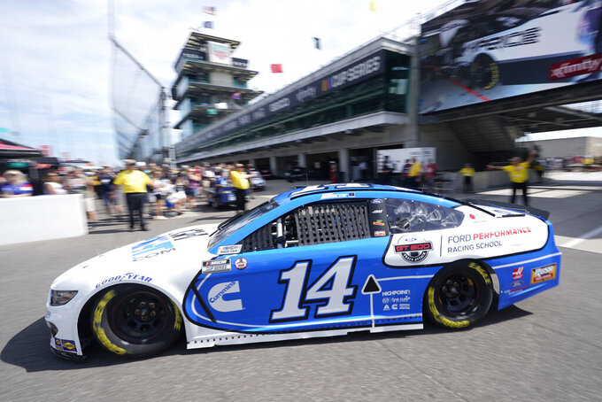 Chase Briscoe pulls out of the garage area during practice for the NASCAR Cup Series at Indianapolis Motor Speedway, Saturday, Aug. 14, 2021, in Indianapolis. (AP Photo/Darron Cummings)