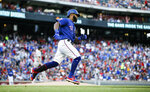 Texas Rangers' Danny Santana rounds the bases after hitting solo home run during the first inning of a baseball game against the Houston Astros, Saturday, July 13, 2019, in Arlington, Texas. (AP Photo/Brandon Wade)