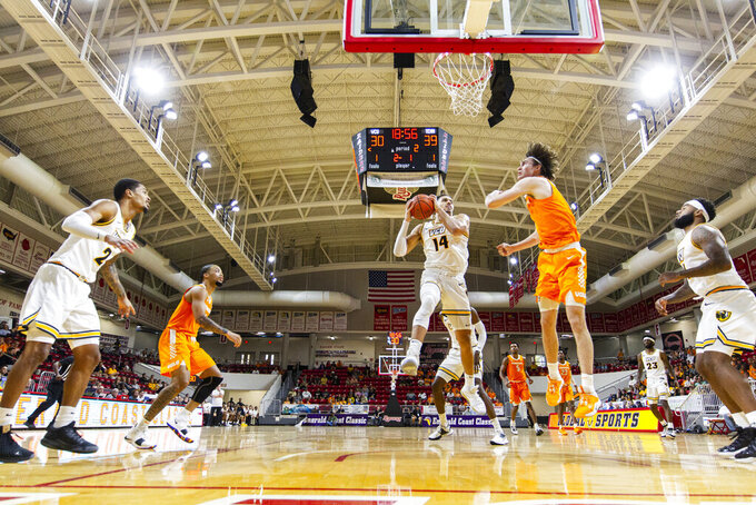 Virginia Commonwealth forward Marcus Santos-Silva (14) comes down with a rebound against Tennessee in the second half of an NCAA college basketball game at the Emerald Coast Classic in Niceville, Fla., Saturday, Nov. 30, 2019. Tennessee defeated Virginia Commonwealth 72-69. (AP Photo/Mark Wallheiser)