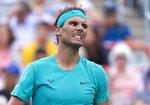 Rafael Nadal of Spain reacts during his match against Daniel Evans of Britain during second round of play at the Rogers Cup tennis tournament, Wednesday, Aug. 7, 2019 in Montreal. (Paul Chiasson/The Canadian Press via AP)