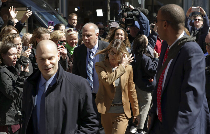 People photograph actress Lori Loughlin as she arrives at federal court in Boston on Wednesday, April 3, 2019, to face charges in a nationwide college admissions bribery scandal. (AP Photo/Charles Krupa)