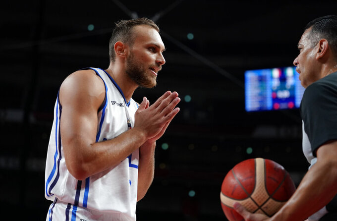 Italy's Stefano Tonut (7), left, interacts with the referee during men's basketball preliminary round game between Italy and Nigeria at the 2020 Summer Olympics, Saturday, July 31, 2021, in Saitama, Japan. (AP Photo/Charlie Neibergall)