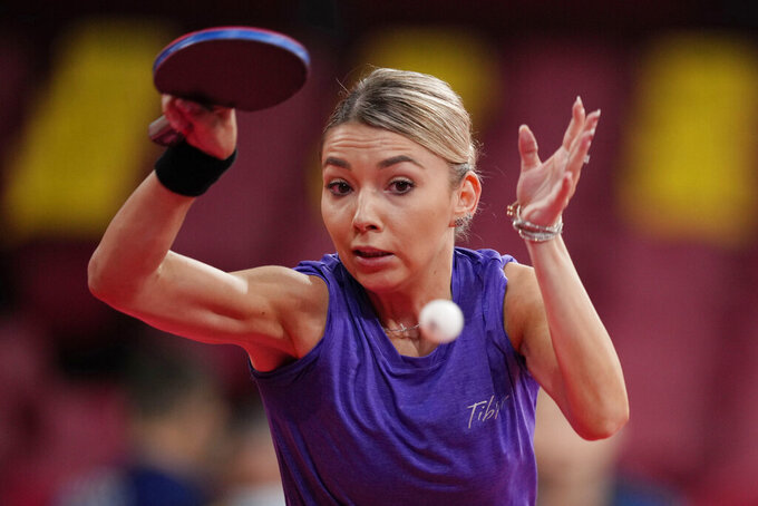 Romania's Bernadette Szocs competes during the table tennis women's team round of 16 against Egypt at the 2020 Summer Olympics, Sunday, Aug. 1, 2021, in Tokyo, Japan. (AP Photo/Kin Cheung)