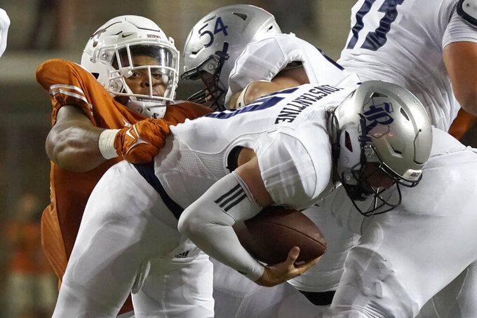 Rice quarterback Jake Constantine (10) is sacked by Texas defensive lineman Byron Murphy II (90) during the second half of an NCAA college football game Saturday, Sept. 18, 2021, in Austin, Texas. (AP Photo/Chuck Burton)