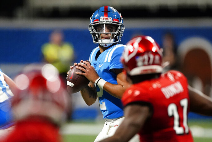 Mississippi quarterback Matt Corral (2) looks for an open receiver during the first half of an NCAA college football game against Louisville, Monday, Sept. 6, 2021, in Atlanta. (AP Photo/John Bazemore)