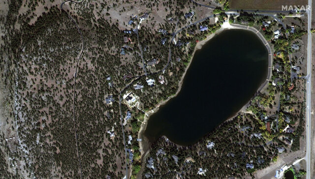 This satellite image provided by Maxar Technologies shows a natural color photo of the Lake of the Pines neighborhood and Allens Lake, Sunday, Oct. 11, 2020, before the CalWood Fire, west of Longmont, Colo., in Boulder County. (Satellite image ©2020 Maxar Technologies via AP)
