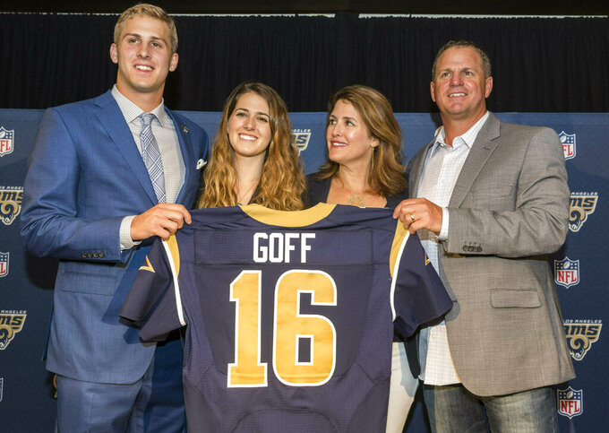 CORRECTS TO NANCY GOFF-File-This April 29, 2016, file photo shows  California's Jared Goff posing for photos with his family after being selected by the Los Angeles Rams as the first pick in the first round of the NFL football draft, in Los Angeles. From left, Jared Goff with sister, Lauren Goff and parents, Nancy Goff and Jerry Goff.  The Montreal Expos would be thrilled with this Super Bowl,  and those who used to be part of the extinct baseball franchise's evaluation process certainly are, even all these years later. Gone from the game for nearly 15 years, the former club has ties to both quarterbacks in Sunday's NFL championship game. The Expos traded for Jared Goff's father, Jerry, nearly three decades ago. Goff made his major league debut for Montreal in 1990 and played 55 games for the team as a backup catcher that year and in 1992.(AP Photo/Damian Dovarganes, File)