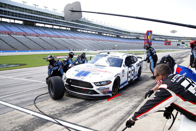 Chase Briscoe makes a pit stop during a NASCAR Xfinity Series auto race at Texas Motor Speedway in Fort Worth, Texas, Saturday, July 18, 2020. (AP Photo/Ray Carlin)
