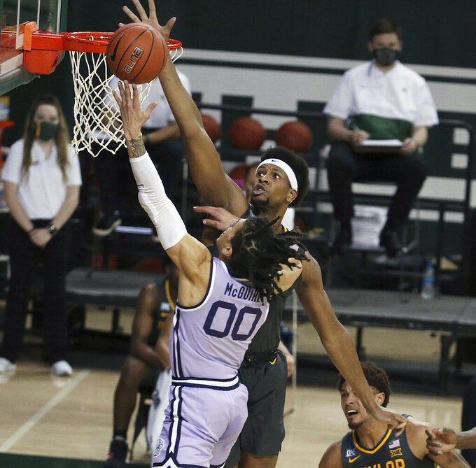 Kansas State guard Mike McGuirl (0) has his shot blocked by Baylor forward Flo Thamba (0) in the first half of an NCAA college basketball game, Wednesday, Jan. 27, 2021, in Waco, Texas. (AP Photo/Jerry Larson)