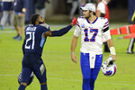 Tennessee Titans cornerback Malcolm Butler (21) talks with Buffalo Bills quarterback Josh Allen (17) after an NFL football game Tuesday, Oct. 13, 2020, in Nashville, Tenn. Butler intercepted Allen twice as the Titans won 42-16. (AP Photo/Mark Zaleski)