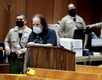 FILE - In this Tuesday, June 23, 2020, file photo, adult film star Ron Jeremy, second from left, makes his first court appearance in Los Angeles. A grand jury has indicted adult film actor Ron Jeremy on more than 30 counts of sexual assault involving 21 women and girls across more than two decades, authorities said. Jeremy, 68, whose legal name is Ronald Jeremy Hyatt, pleaded not guilty in Los Angeles Superior Court on Wednesday, Aug. 25, 2021 to all of the allegations, which include 12 counts of rape.  (Robert Gauthier/Los Angeles Times via AP, Pool, File)